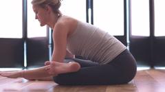 Seated woman doing yoga medium shot Stock Footage
