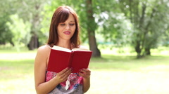 woman reading book - stock footage