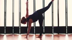 Beautiful young woman doing yoga medium shot Stock Footage