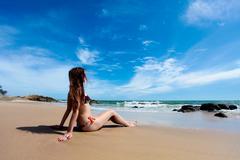 Beauty woman and amazing sand beach Stock Photos