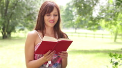 Woman reading book Stock Footage