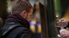 Two Men Buying Mulled Wine At Christmas Market Shot On R3D Stock Footage