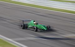 Motion blur of racing car - stock photo
