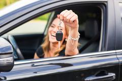 Young Happy Woman Showing The Key Of New Car - stock photo