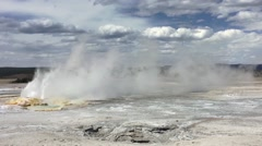 Geyser Blowing steam across field Stock Footage