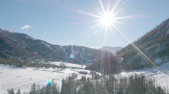 Aerial of beautiful mountains and trees on a sunny winter day Stock Footage