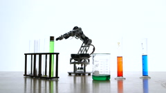 Robotic arm starting a chemical reaction Stock Footage