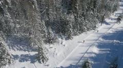 Aerial of skiers skiing on ski slope Stock Footage