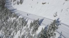 Aerial of skier skiing on ski slope Stock Footage