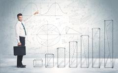 Business man climbing up on hand drawn graphs concept - stock photo