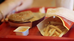 Fast food hamburger and french fries on a tray Stock Footage