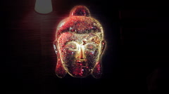 Decorative Brilliant Buddha Face Sparkling In The Dark - stock footage
