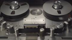 2 inches analog audio tape machine in Play and Stop mode - stock footage