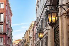 Ancient lamp on Venetian Street Stock Photos