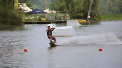 Athlete wakeboarder floats on water - stock footage