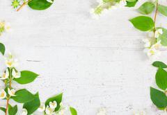 Jasmine flowers on wooden table - stock photo