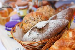 Fresh homemade bread loafs in basket Stock Photos