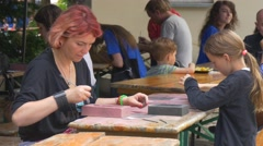 Festival of High Temperatures in Wroclaw Woman and Kid Craftspeople Are Stock Footage
