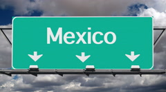 Mexico Border Crossing Highway Sign with Time Lapse Clouds - stock footage