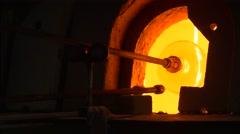 Glassblower Puts a Statuette Pedestal Into Flame Glassblowing Furnace Festival Stock Footage