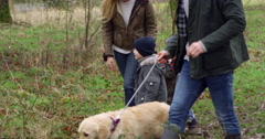 Family On Winter Walk In Countryside With Dog Shot On R3D Stock Footage