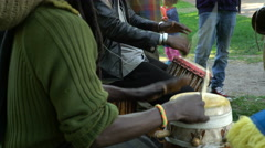 The natives of Somalia and the locals sing and play drums in a City Park - stock footage