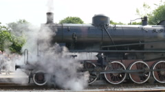 Steam Locomotive and Train Leaves Trains Station Stock Footage