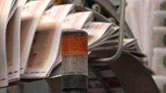 industrial printing press newspapers flickering light symmetric shot - stock footage