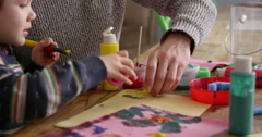 Mother And Son Sitting At Home Painting Picture Shot On R3D Stock Footage
