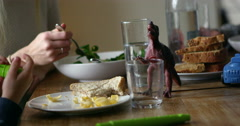 Family Sitting At Kitchen Table And Eating Meal Shot On R3D Stock Footage