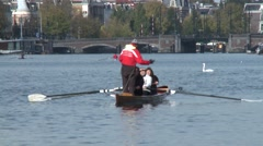 People in kayak in amsterdam canal Stock Footage
