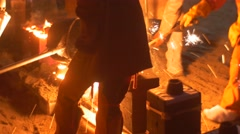 Workers Casting a Liquid Metal Into the Molds Bright Orange Metal Shining in Stock Footage