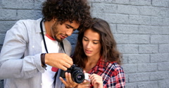 Friends looking at pictures on camera Stock Footage