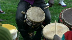 The natives of Somalia and the locals sing and play drums in a City Park. - stock footage