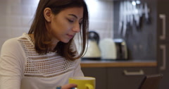 Woman Working On Digital Tablet In Apartment Shot On R3D Stock Footage