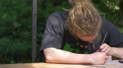 Festival of High Temperatures in Wroclaw Craftsmen With Dreads is Grinding Mold Stock Footage