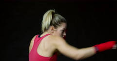 Athletic young blonde woman shadow boxing, shot on R3D Stock Footage