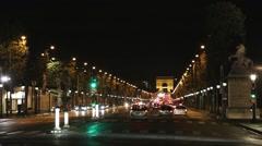 Champs-Élysées Paris traffic France at night Stock Footage