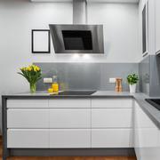 Yellow tulips in kitchen - stock photo