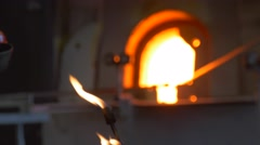 Glassblowers Around Furnace Men Are Heating Molding a Sculptures Festival of Stock Footage