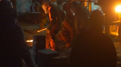 Workers Silhouettes Casting Metal in Furnace Night Cityscape Festival of High Stock Footage