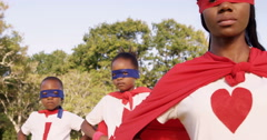 Family posing in costume of superheroes Stock Footage