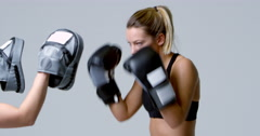 Female boxer training against mitts of a sparring partner, shot on R3D Stock Footage