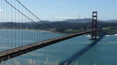 Golden Gate Bridge on grassy wind blown hilltop above San Francisco with zoom Stock Footage