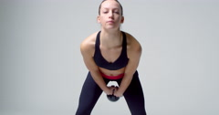 Athletic blonde woman exercising with kettlebell, front view, shot on R3D Stock Footage