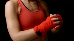 Female boxer checking her wrapped fists, close-up shot Stock Footage