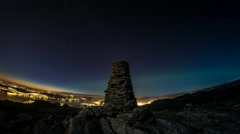 Bjoergvin | Aurora Onset and Stars over Cairn Stock Footage