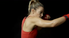 Blonde female boxer shadow boxing, side view Stock Footage