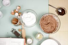 cooking table ingredients flour chocolate cacao closeup bowls cups - stock photo