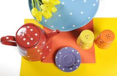 Modern bright Sixties color blocking table setting - stock photo